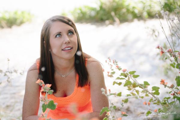 Arizona college girl looking at blowing dandelions