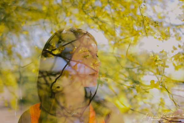 double exposure of girl with yellow palo verde flowers