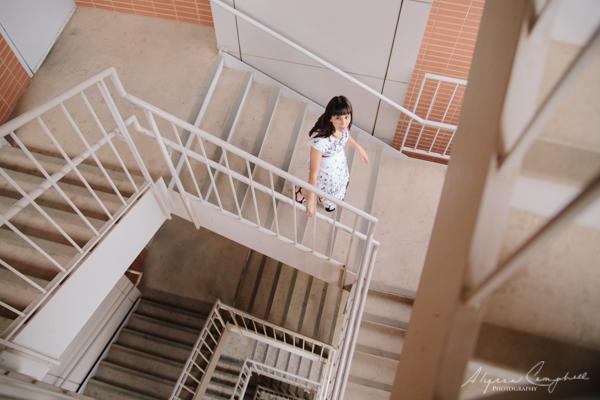 Arizona college graduate portrait in a spiral staircase