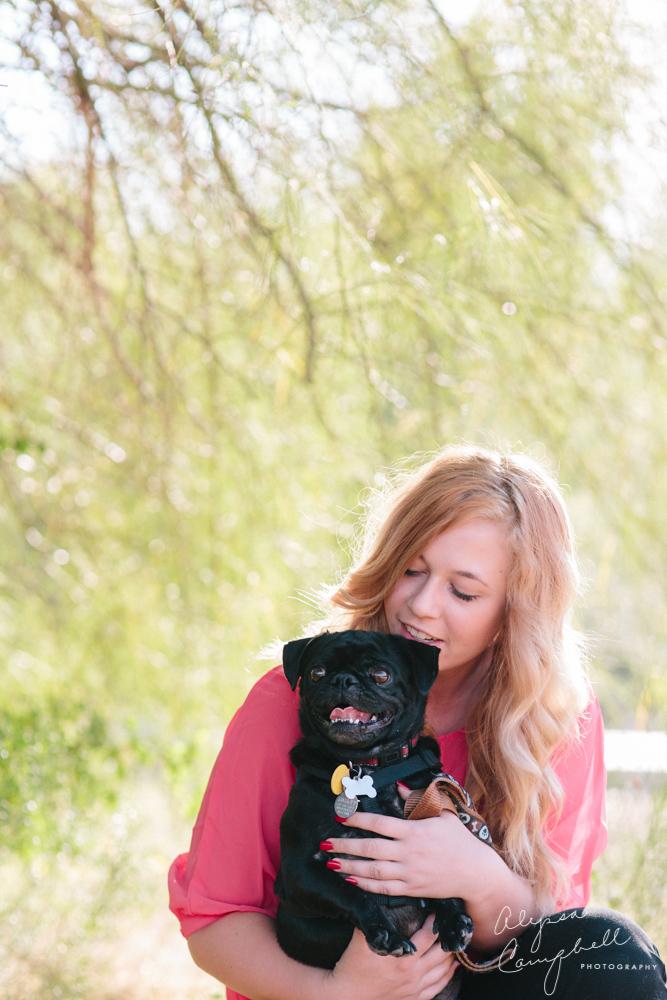 strawberry blonde high school senior with black pet pug