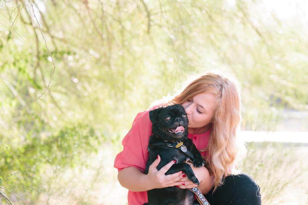 strawberry blonde high school senior girl with black pug