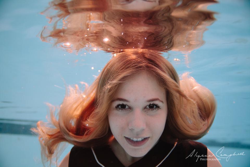underwater high school senior photo with hair floating around