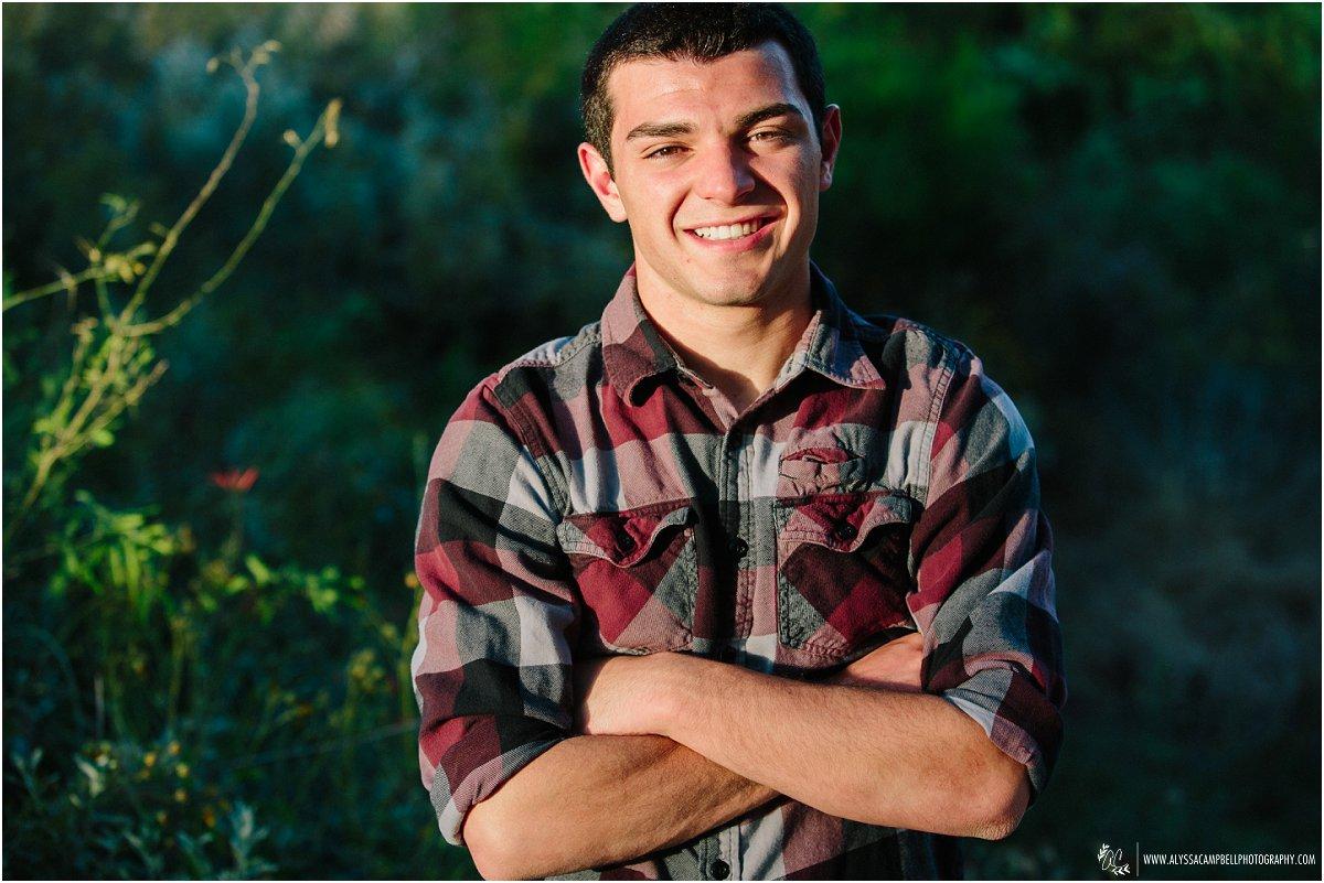 high school senior guy smiling genuinely laidback portraits by Mesa AZ senior photographer Alyssa Campbell