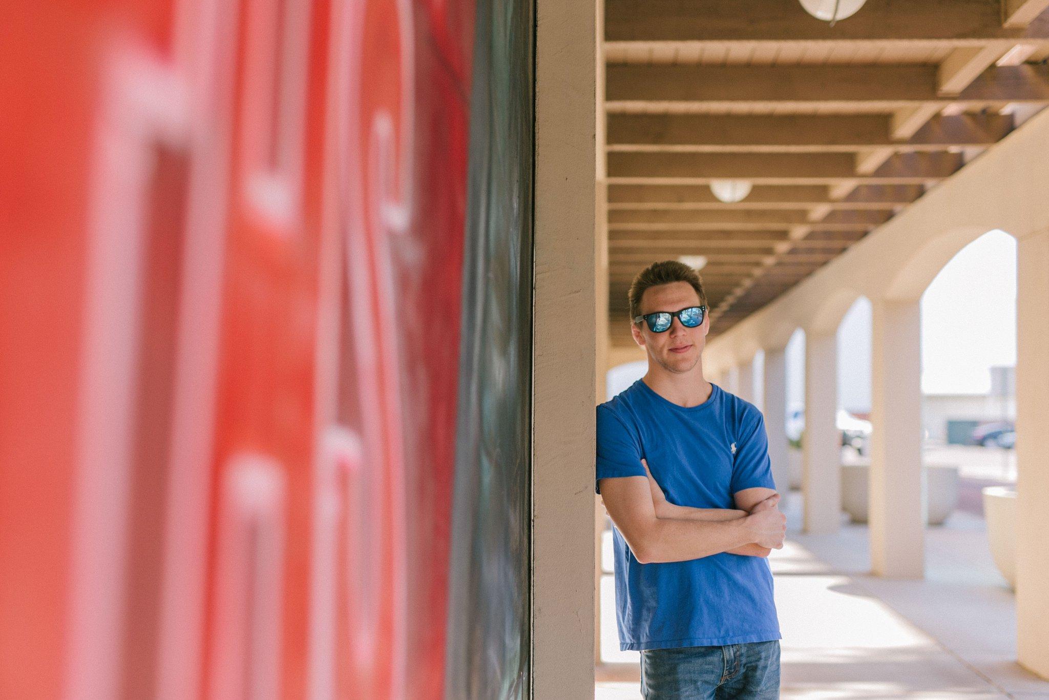 colorful downtown murals urban Arizona college graduation portraits guy