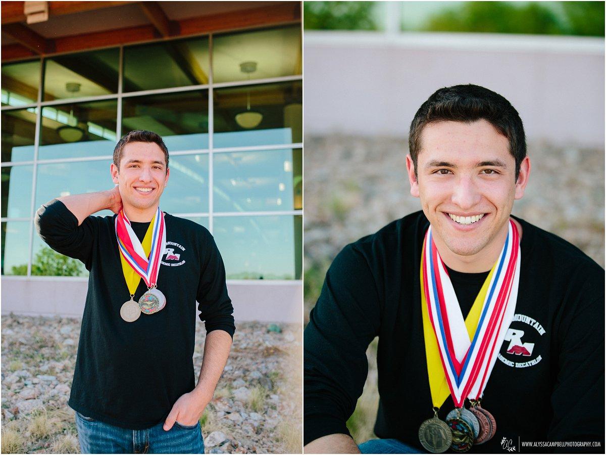high school senior boy with academic medals by Mesa senior photographer Alyssa Campbell