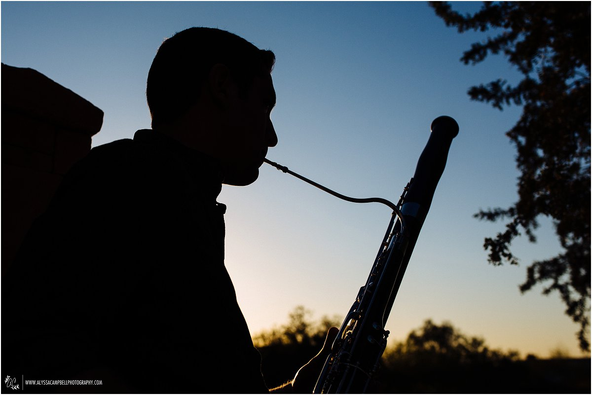 silhouette of bassoon player in sunset by Mesa high school senior photographer Alyssa Campbell