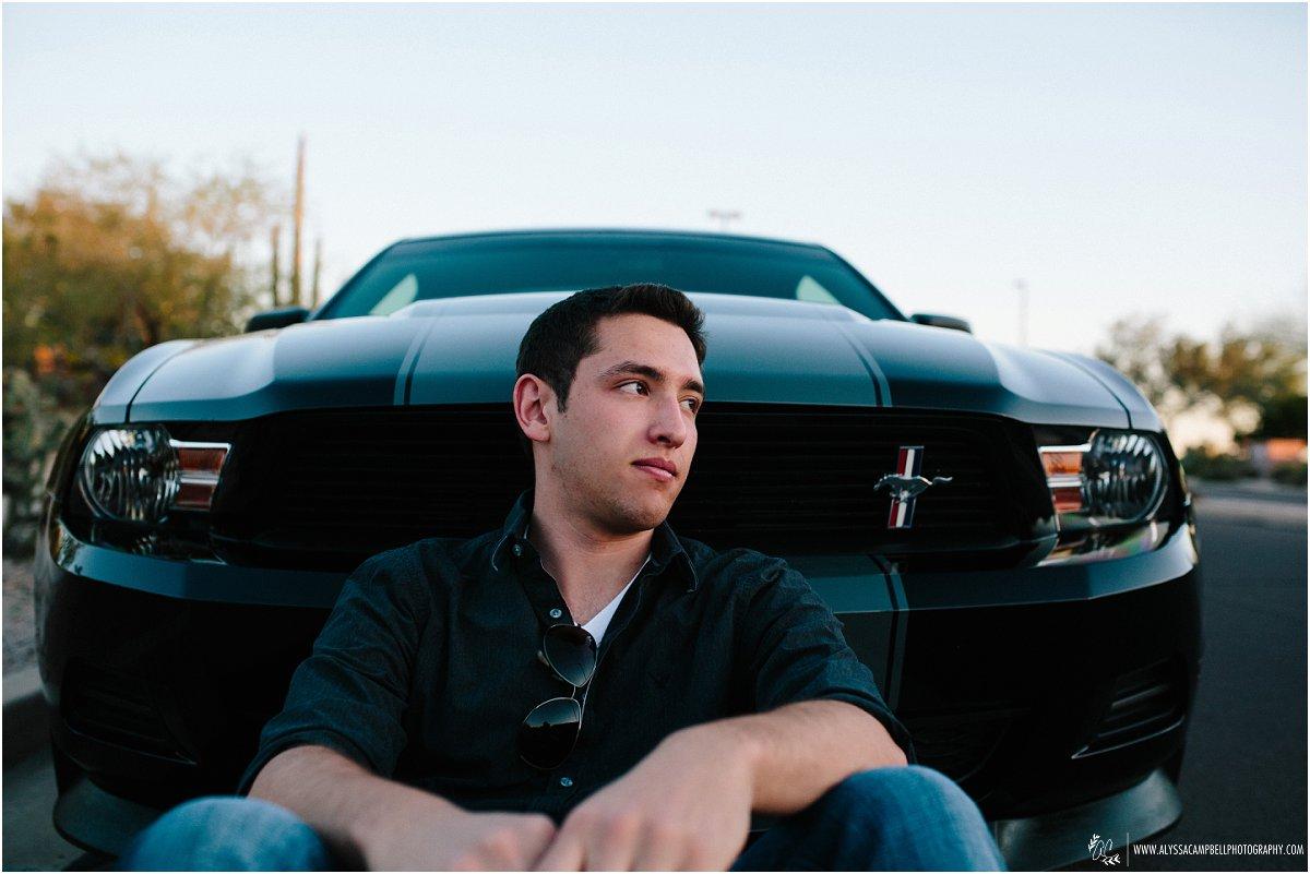cool photo of Mesa high school senior boy in front of Mustang by Mesa high school senior photographer Alyssa Campbell