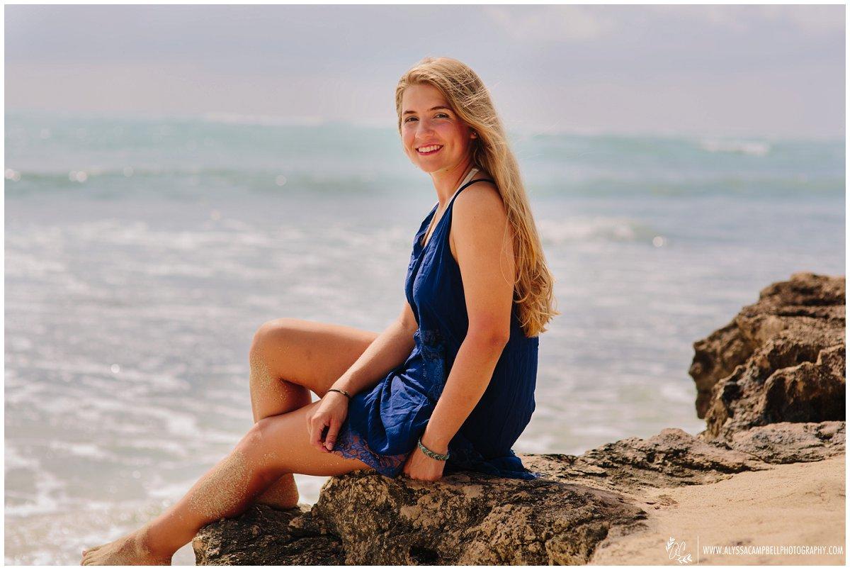 Oahu senior girl on rocky beach casual graduation portraits
