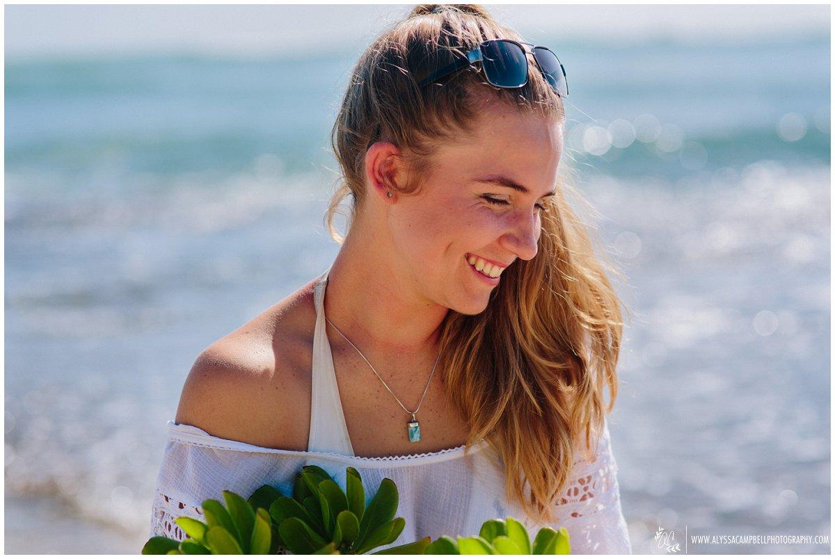 Oahu high school portraits on a beach