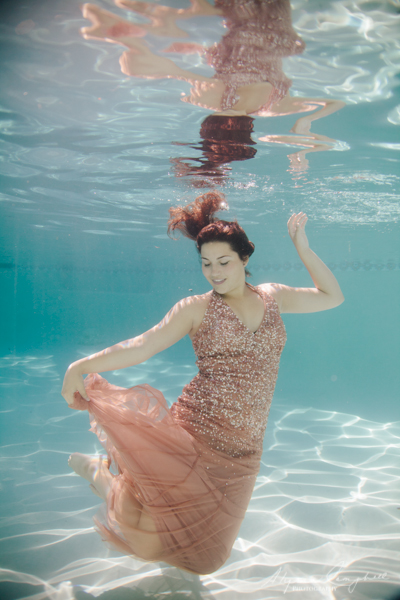 arizona trash the prom dress session in a pool with pink sequin dress