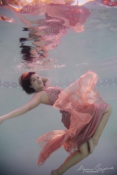 elegant underwater senior photo in prom dress dancing