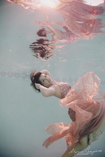 high school senior girl in prom dress underwater