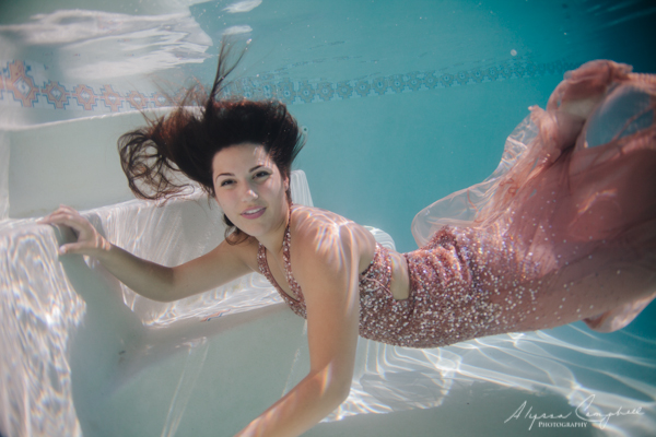 prom dress trash the dress session underwater with dark haired girl in pink sequined prom dress