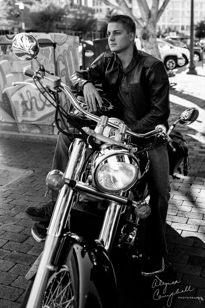 college guy on Mill Ave Tempe AZ on motorcycle in black and white
