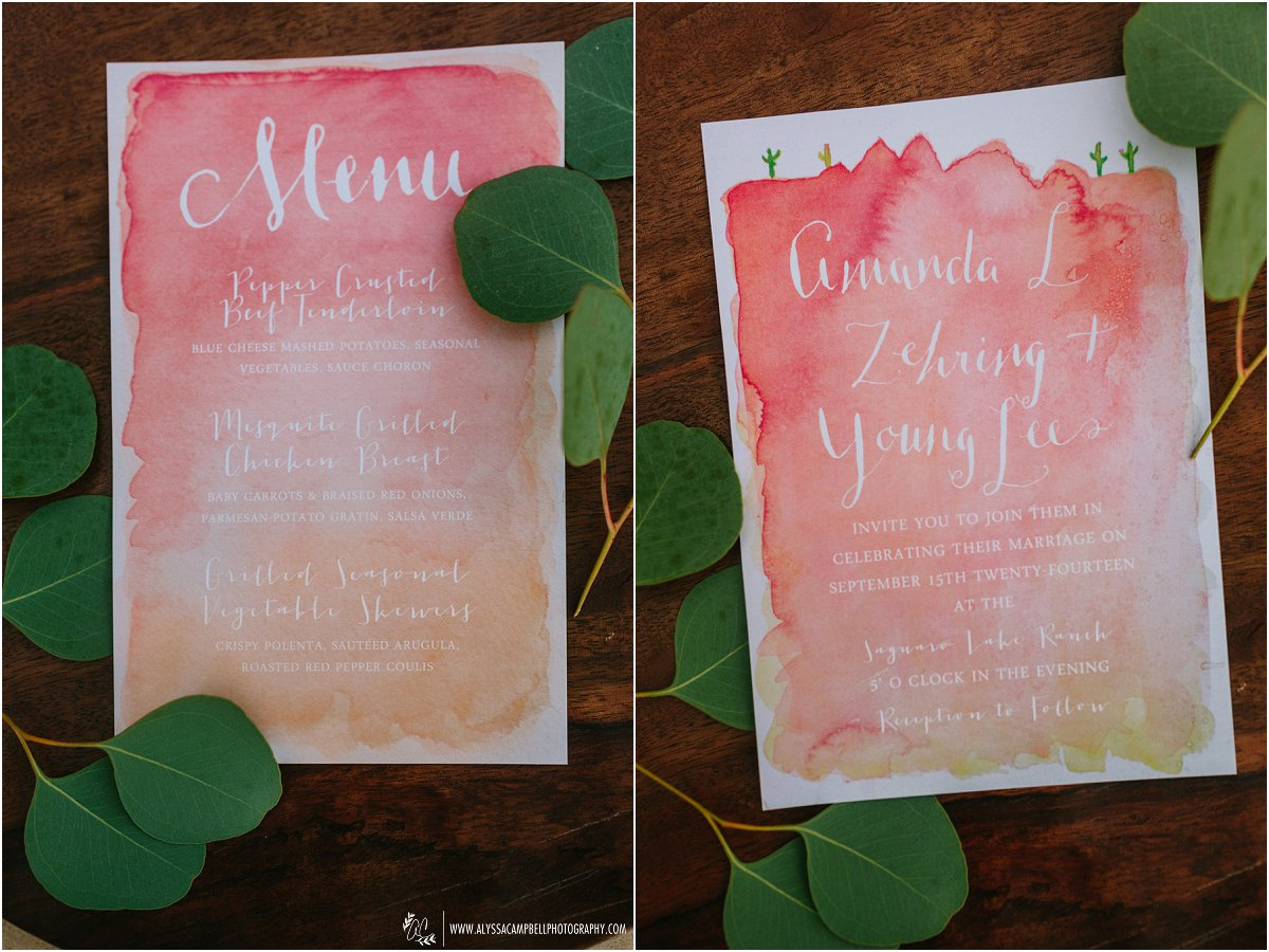 beautiful red watercolor wedding invitations with white calligraphy on wooden charger at Saguaro Lake Ranch wedding by Mesa wedding photographer Alyssa Campbell Photography