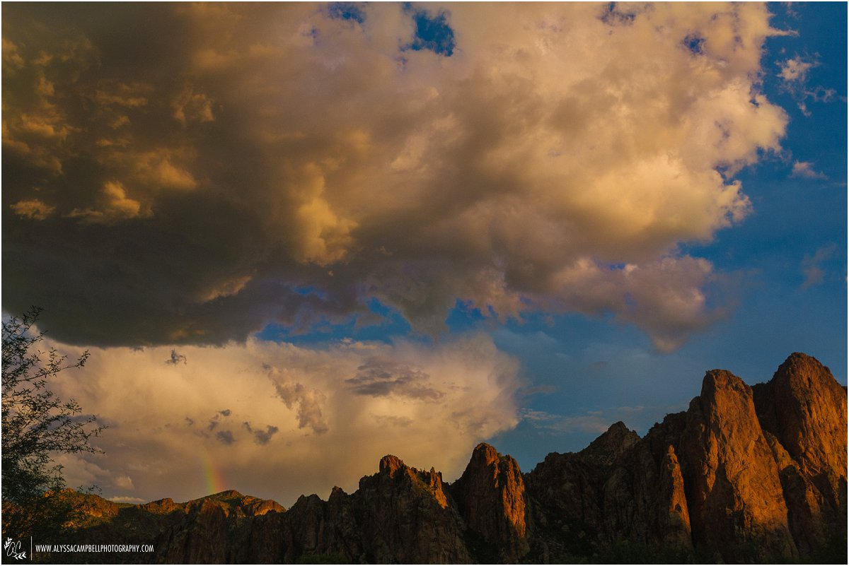 beautiful Arizona mountains at sunset with moody clouds and rainbow