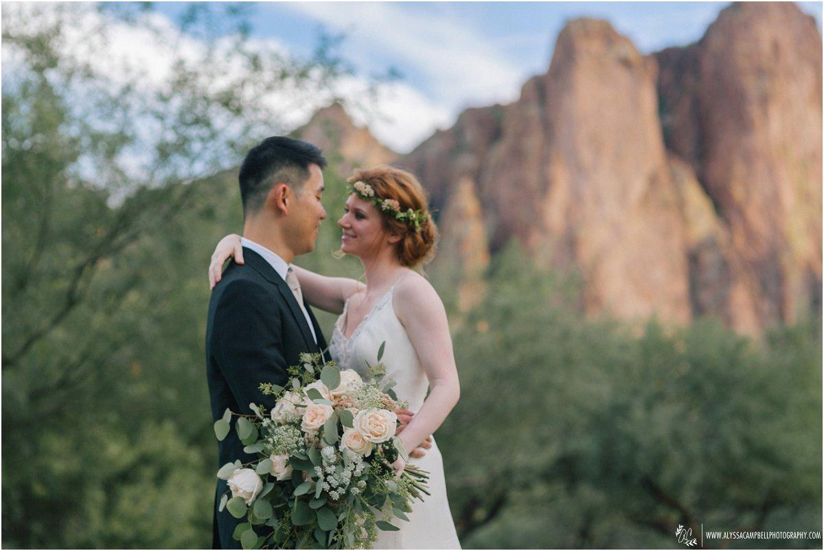 bride & groom first dance with big beautiful loose bouquet at Saguaro Lake Ranch Mesa wedding photographer Alyssa Campbell
