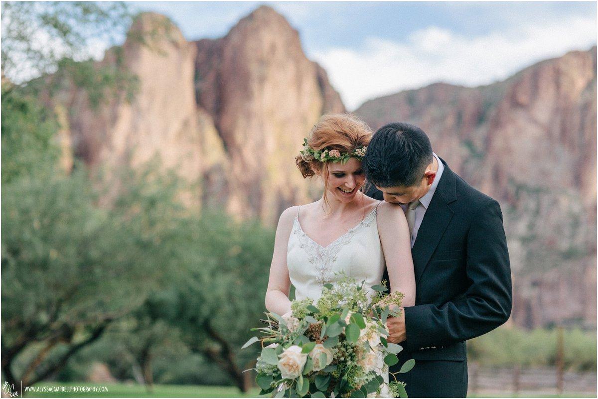 sweet moment between bride & groom at Saguaro Lake Ranch Arizona desert wedding Mesa wedding photographer Alyssa Campbell