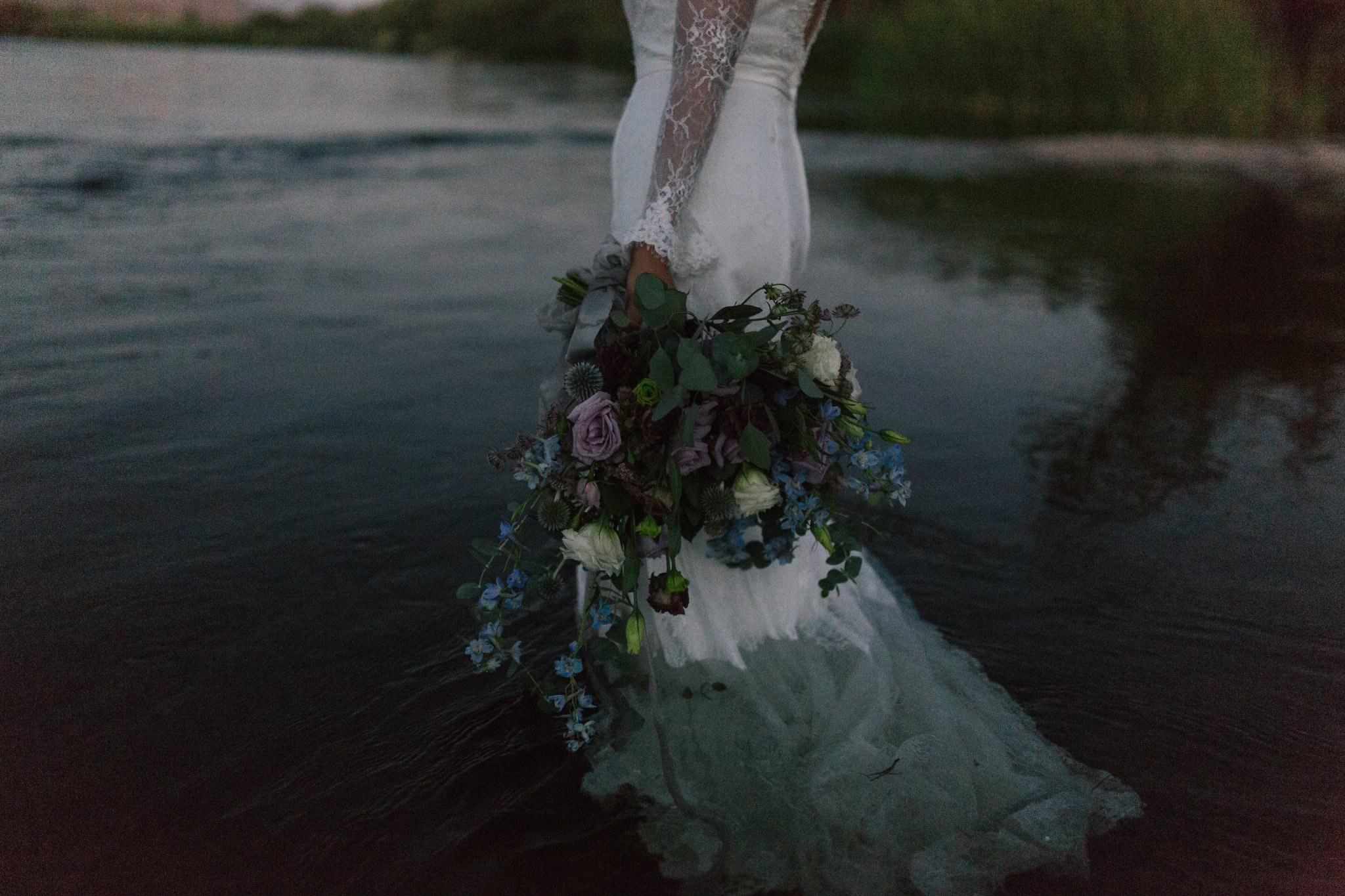 wedding bouquet dark romantic in the river