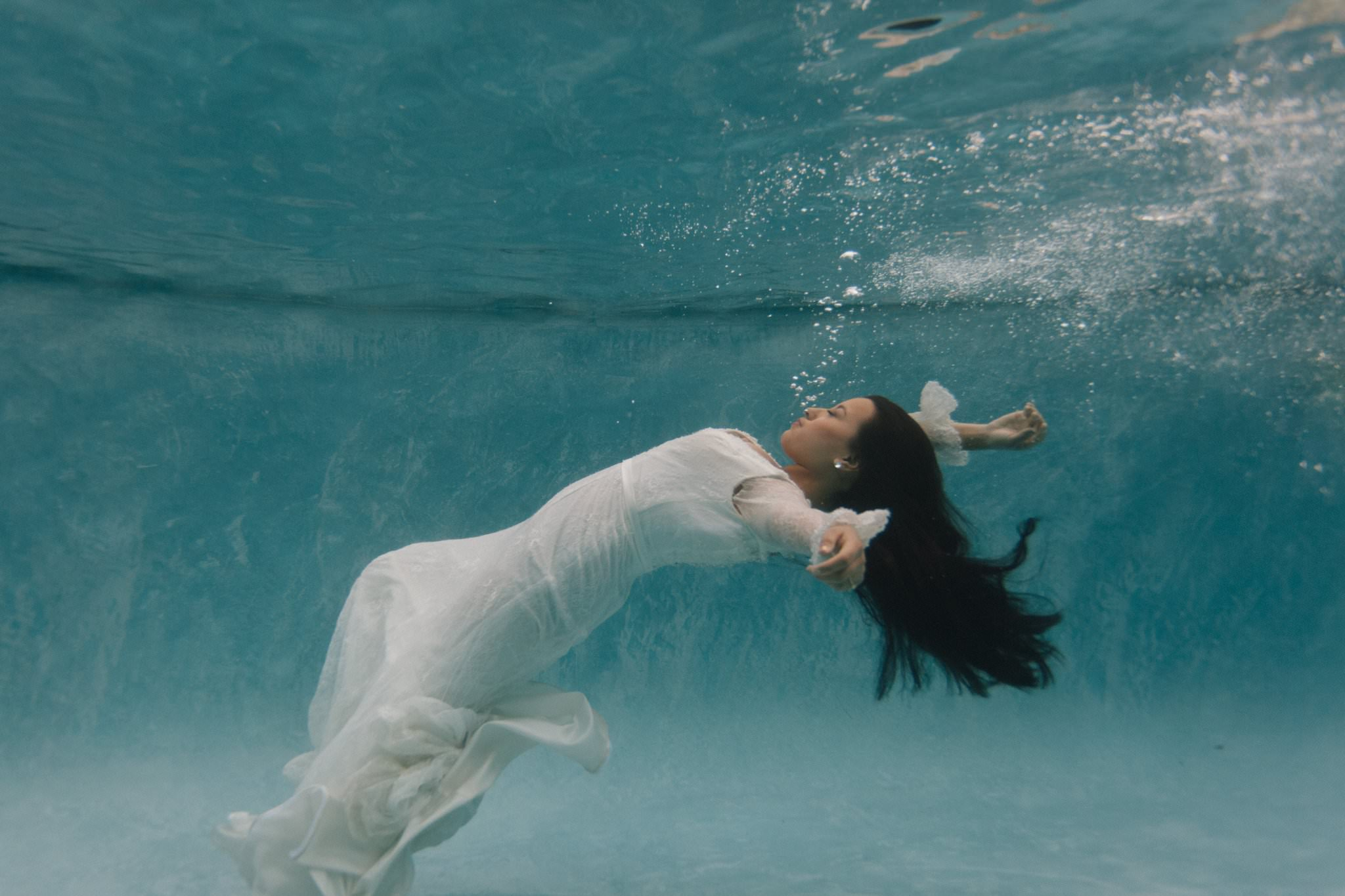 bride sinking underwater Arizona underwater trash the dress photographer