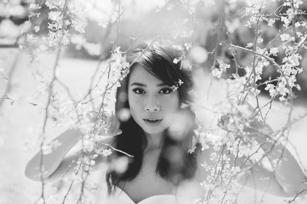 filipino bride looking through palo verde flowers in black & white
