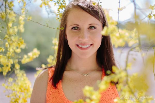 Arizona University college graduate portrait in palo verde tree flowers