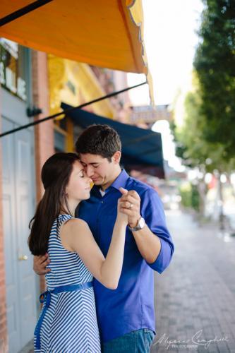 couple slow dancing in downtown Tempe AZ engagement photo