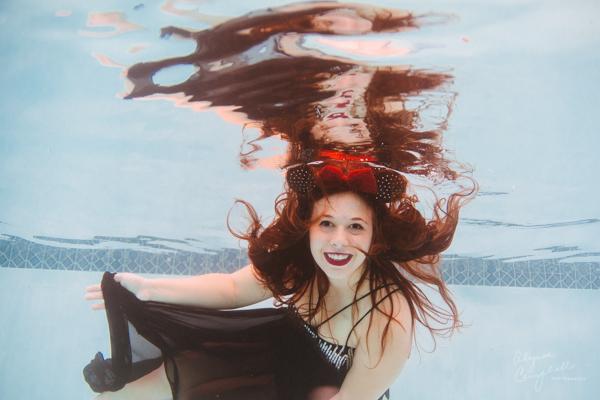 cute senior girl underwater in dress & Minnie Mouse ears