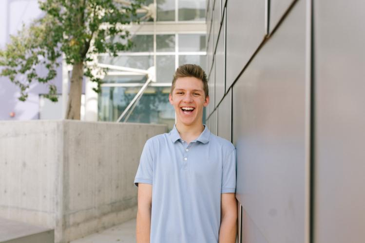 natural candid laughing portrait of high school boy in downtown Mesa