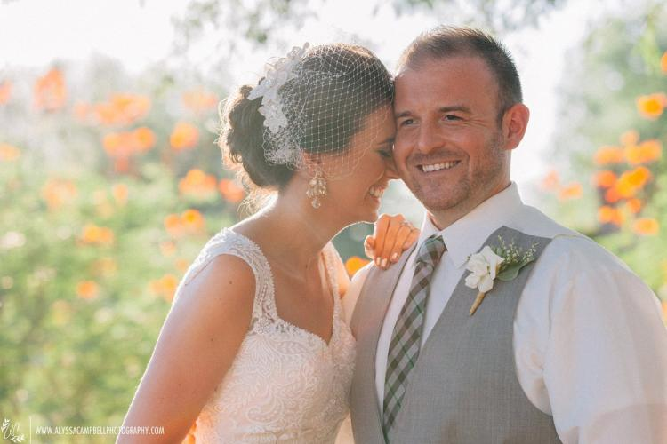 Natural elegant windmill winery barn wedding photo of bride and groom laughing by Phoenix wedding photographer Alyssa Cambell