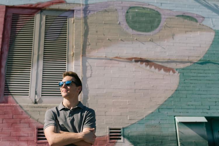 cool Arizona State University graduate portraits in front of shark mural