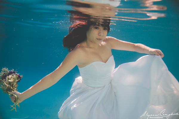underwater trash the dress bridal session in a pool
