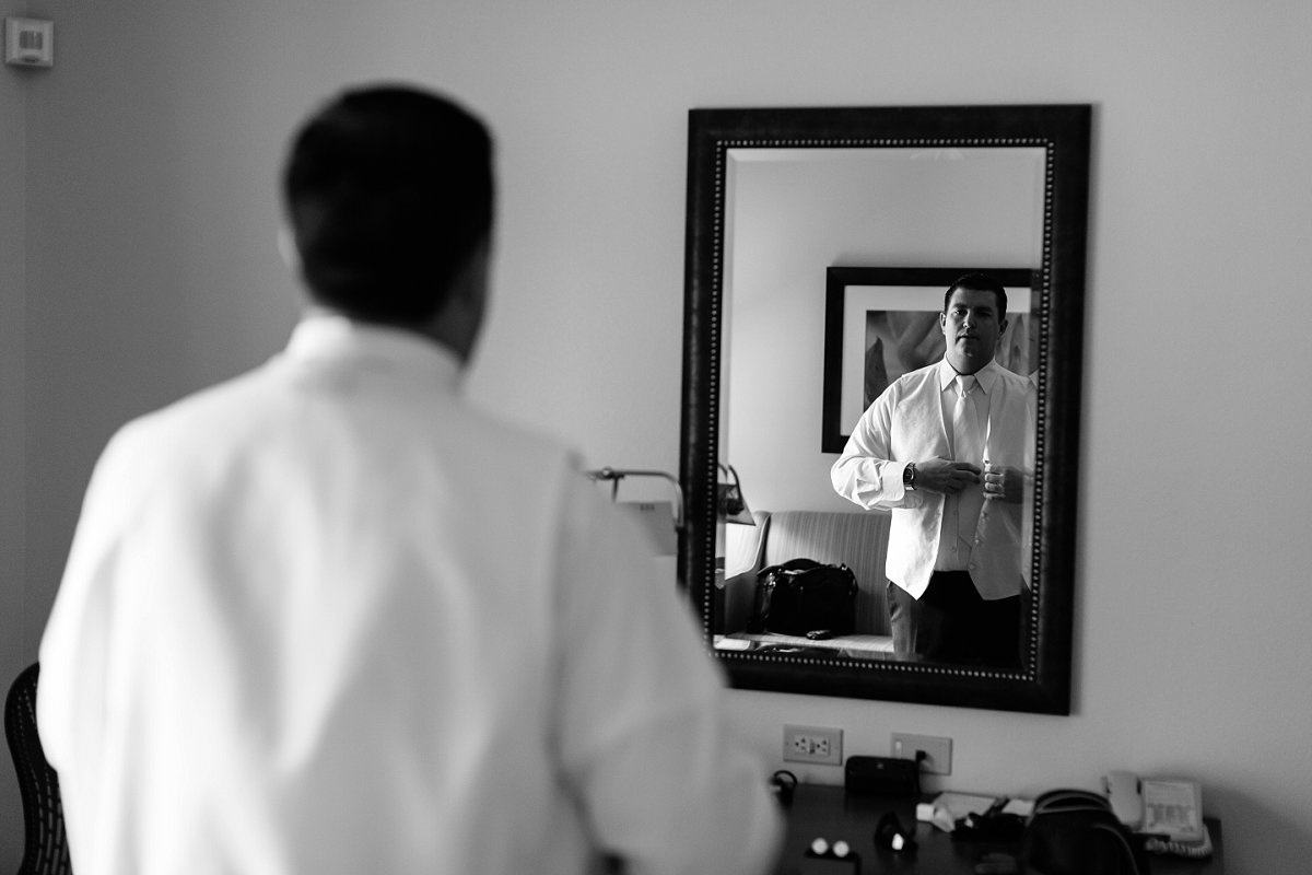 groom getting ready for Sassi wedding in Scottsdale