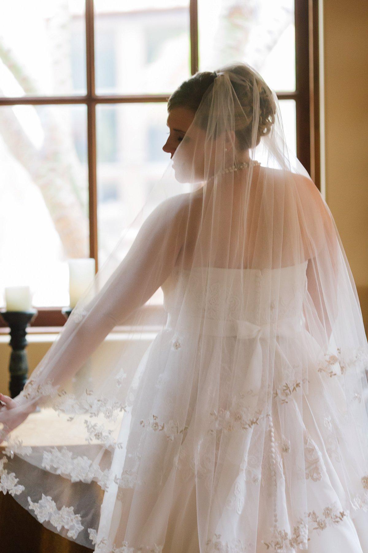 bride in window at Sassi in Scottsdale