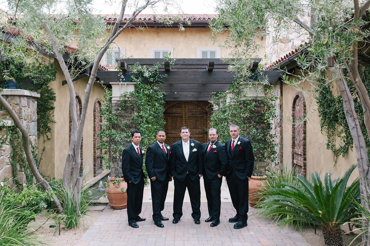 classy red & white wedding at Tuscan desert wedding venue Sassi