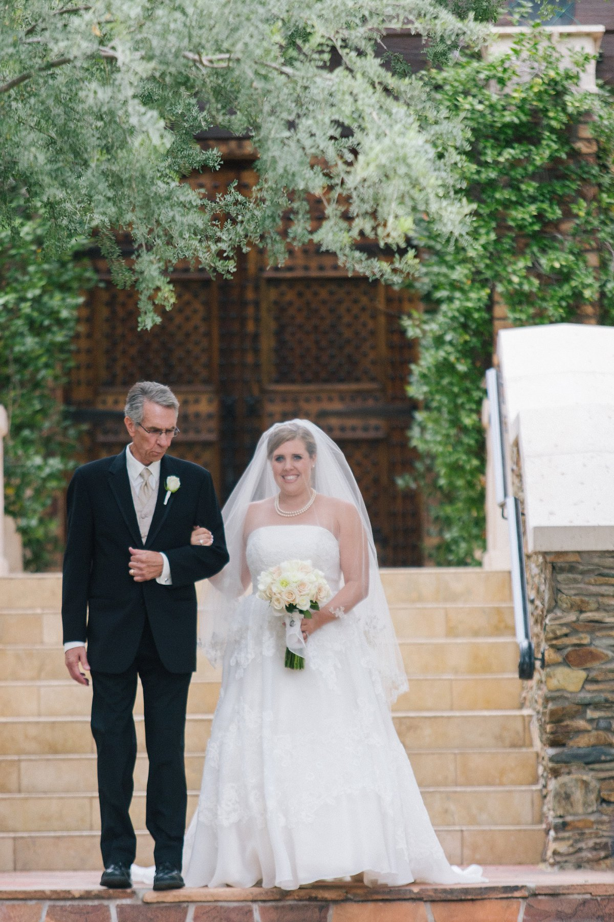 bride & father walking down to ceremony at Sassi