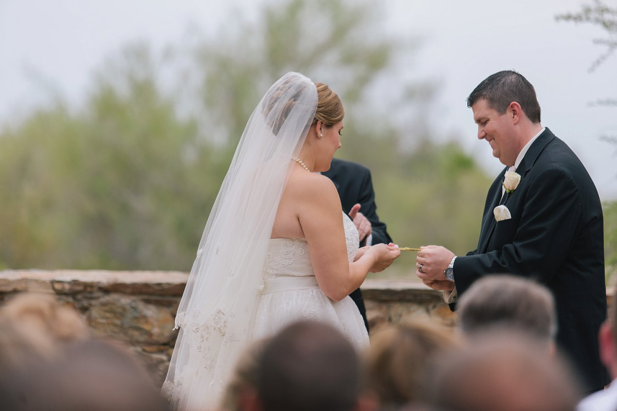 bride & groom tying the knot during ceremony at Sassi in Scottsdale Arizona