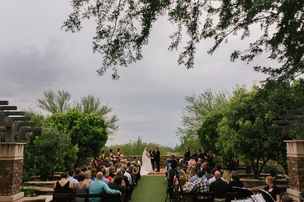 rainy outdoor ceremony at Sassi in Scottsdale AZ tuscan wedding venue