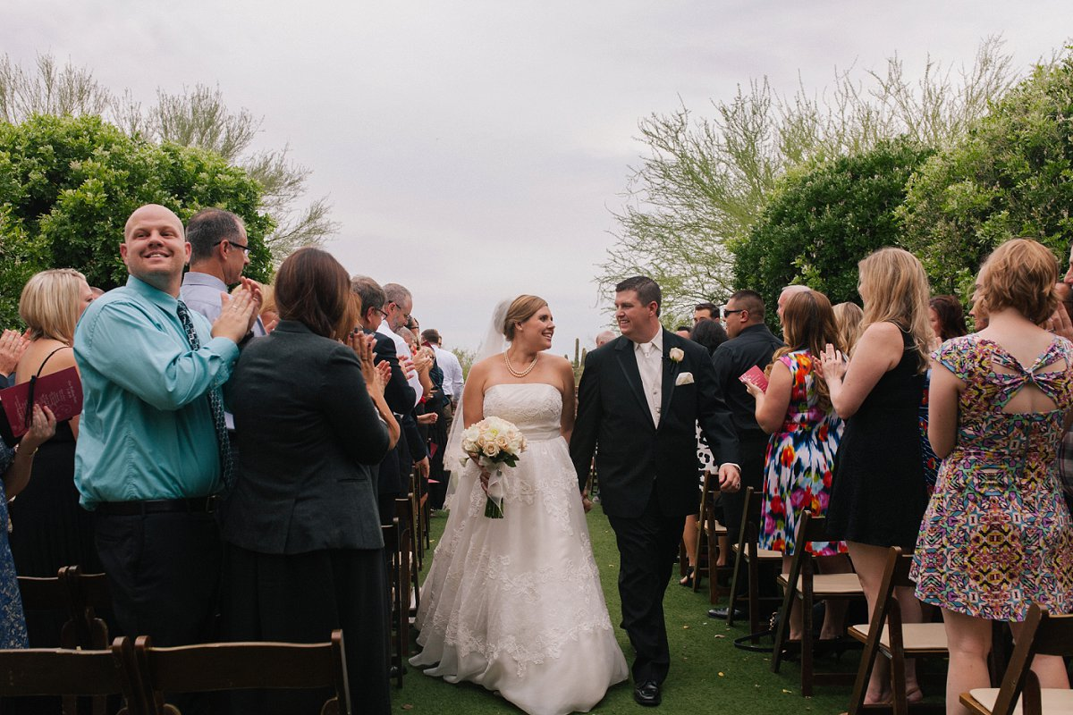 rainy outdoor ceremony at Sassi in Scottsdale AZ tuscan wedding venue