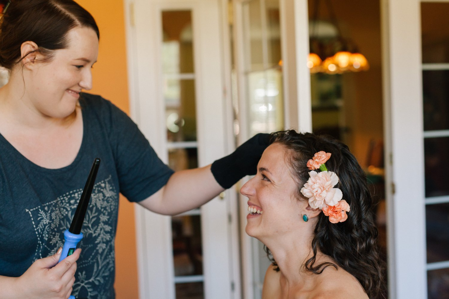bride getting ready at home in Phoenix with flowers in hair moment documentary photographer