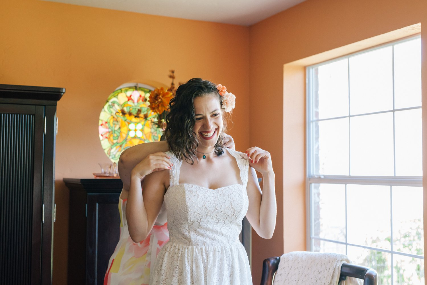 bride getting into dress at home Phoenix