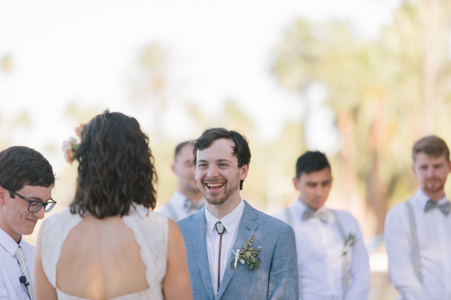 candid groom laughing wedding ceremony Encanto Park AZ