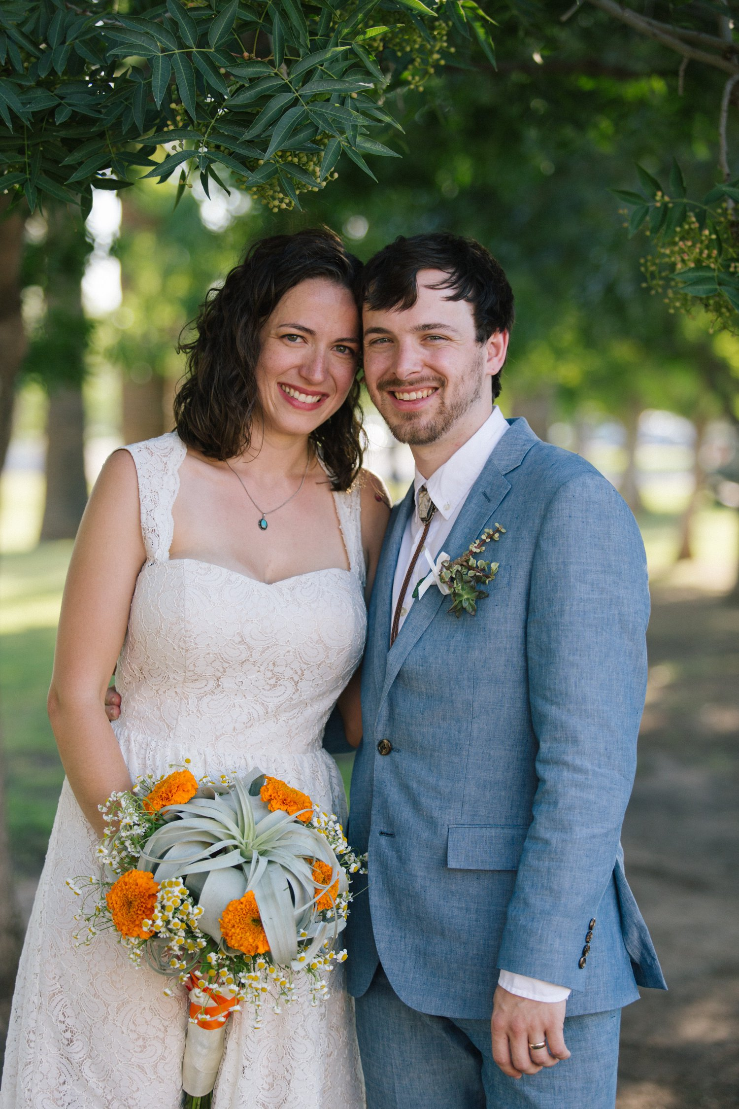 bride & groom in short lace dress and linen suit Phoenix wedding photographer