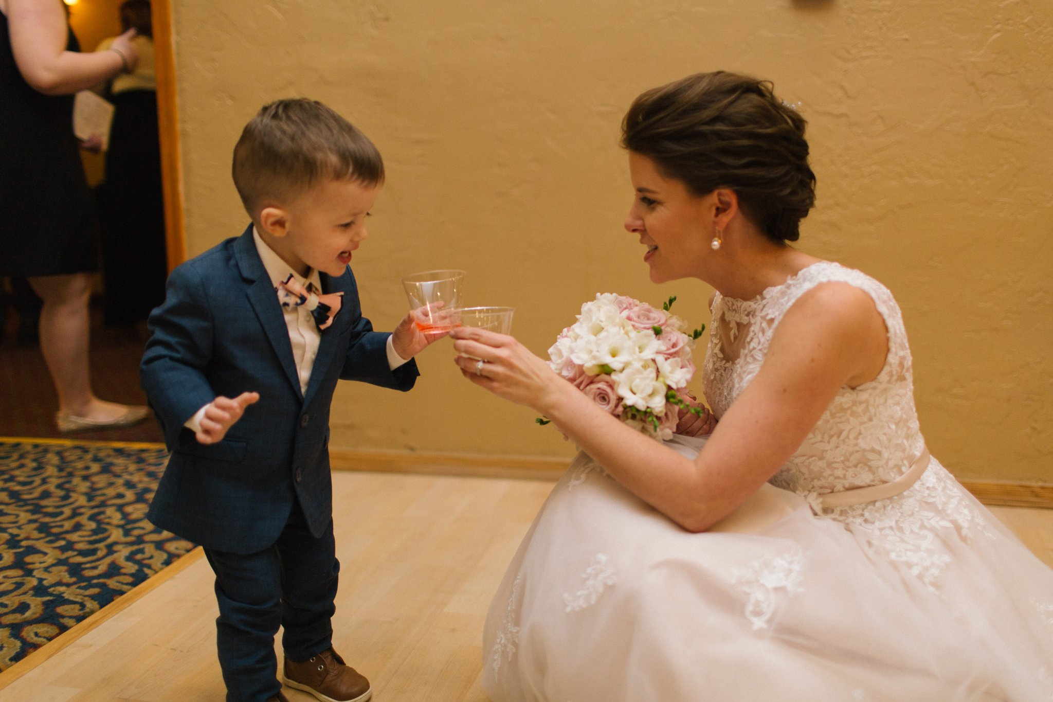 ringbearer and bride toasting at Gold Canyon Golf Resort