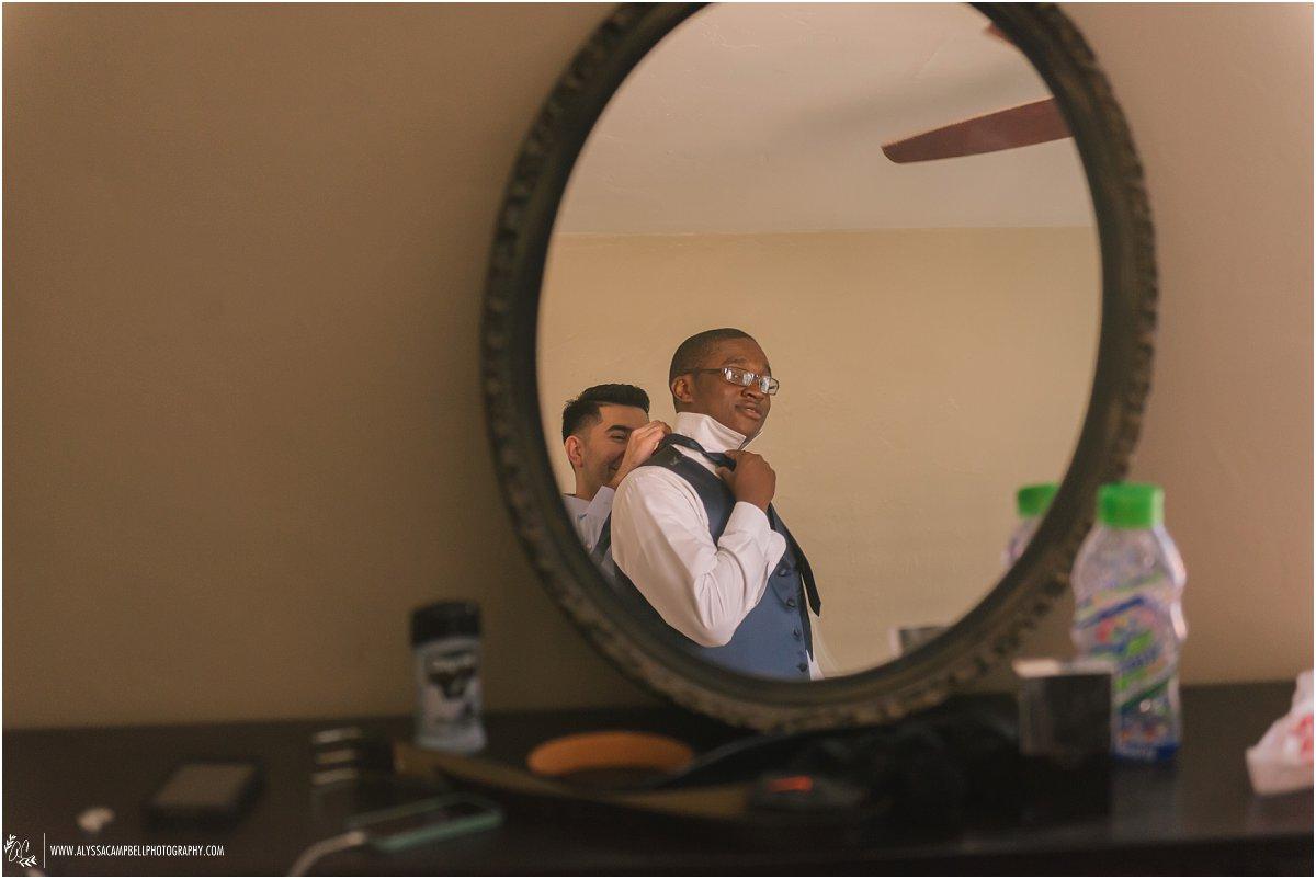 groomsmen getting ready in mirror