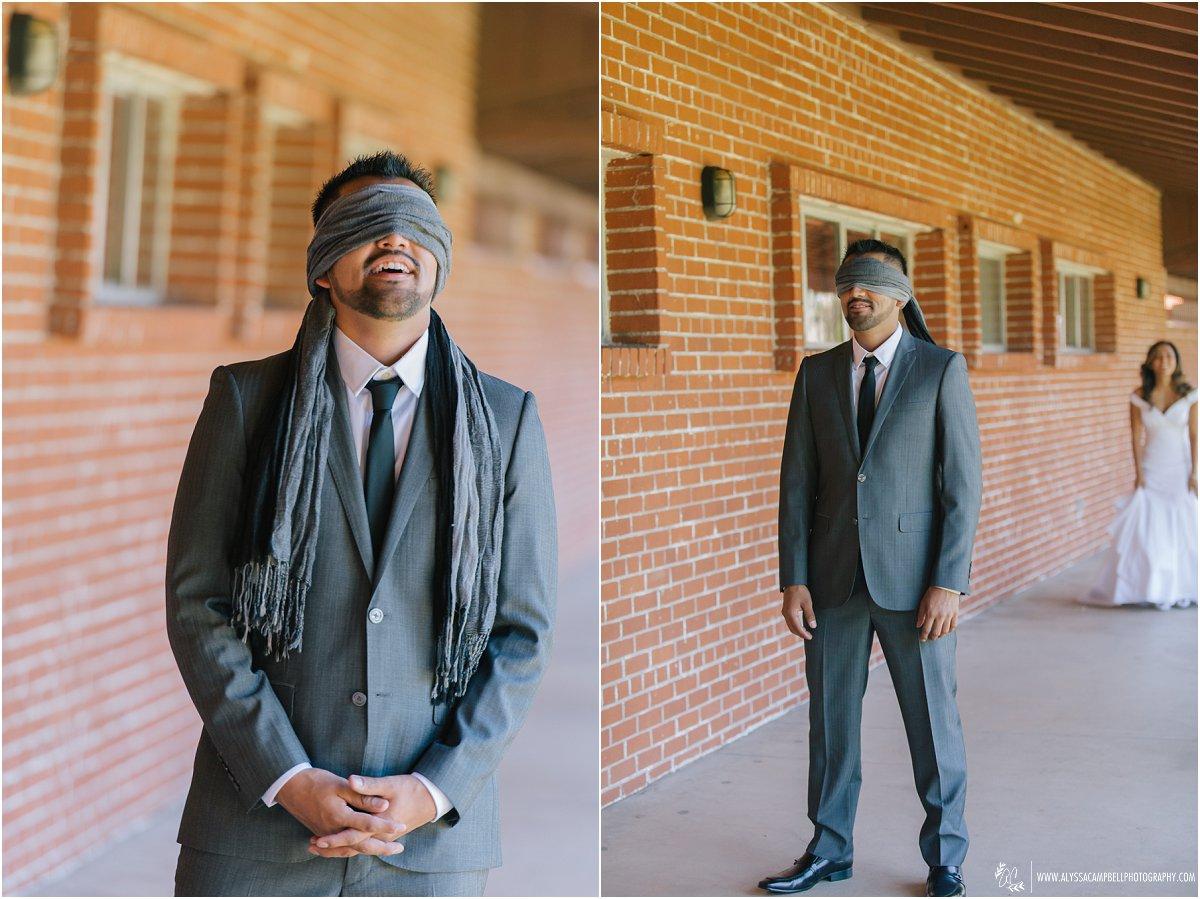 blindfolded groom first look at St Agnes Catholic Church Phoenix AZ