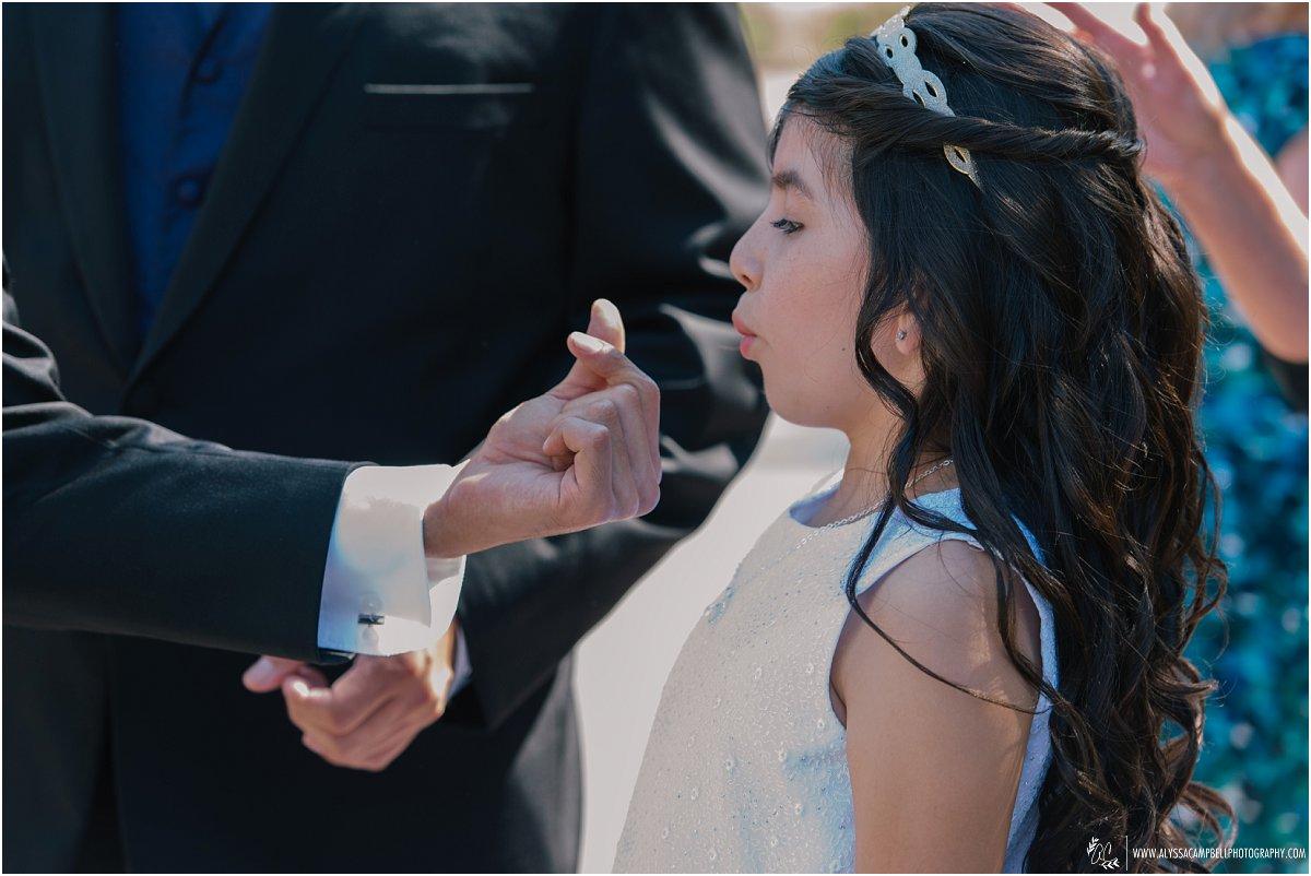 flower girl blowing eyelash making a wish