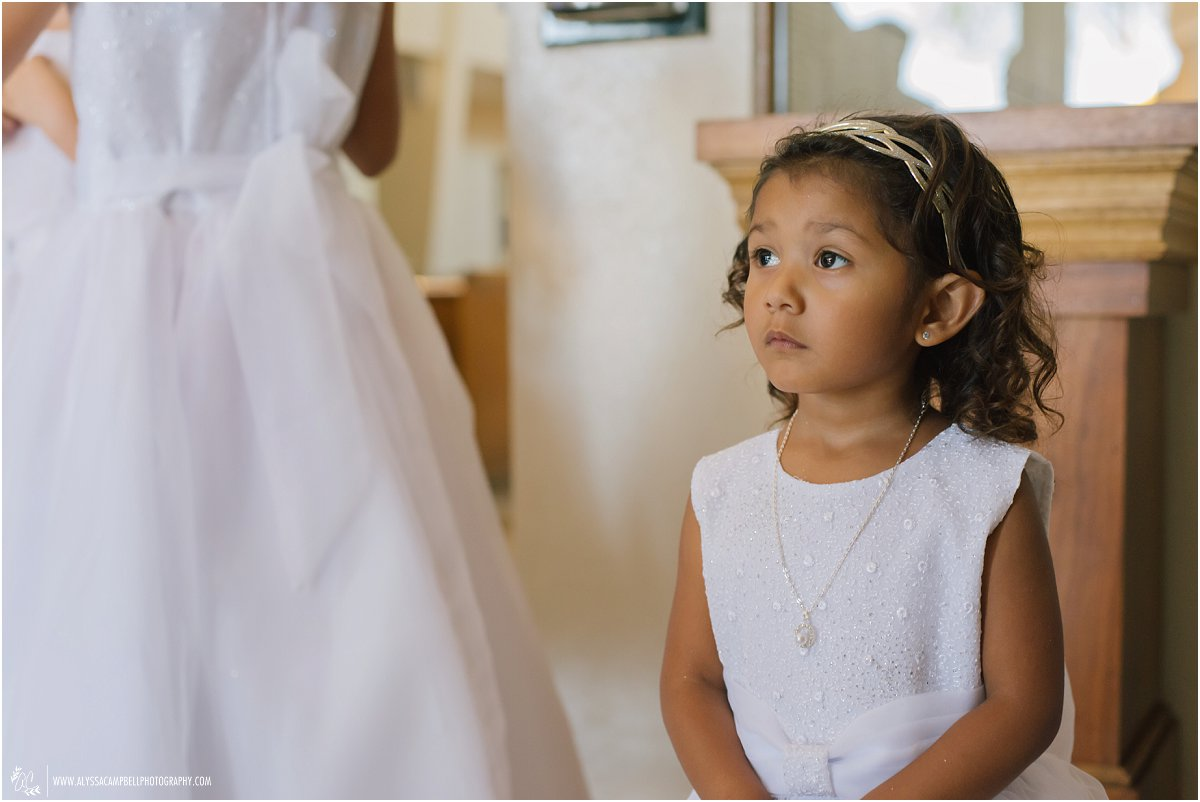 young flower girl waiting for ceremony to start