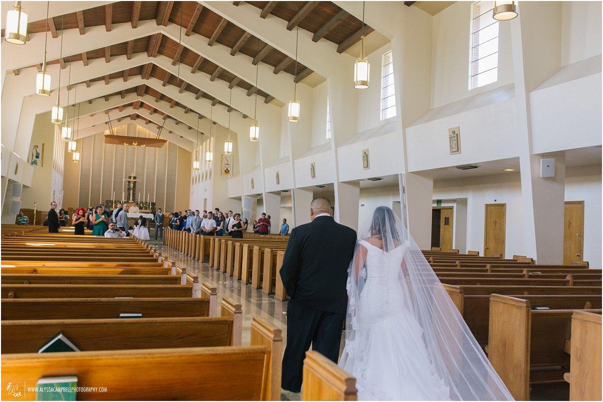 bride & father walking down St Agnes Church aisle in Phoenix