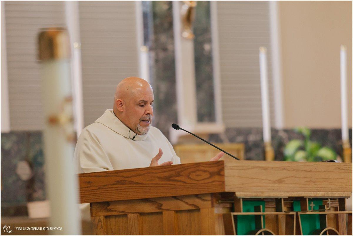Catholic priest performing wedding ritual at St Agnes Church Phoenix